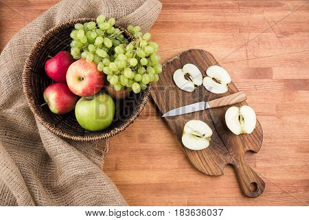 Fresh Seasonal Fruits, Apples And Grapes In Bowl On Rustic Wooden Background