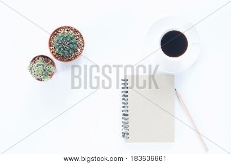 Notebook with pencil coffee cup and cactus on white background