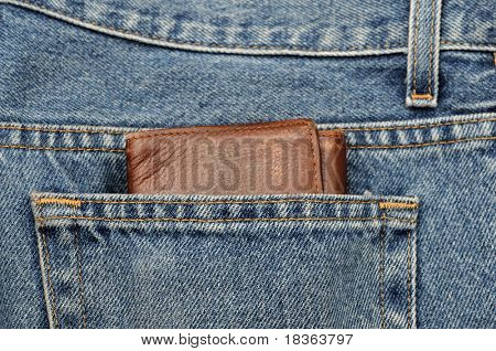 a clean blue jeans with wrench in the back pocket