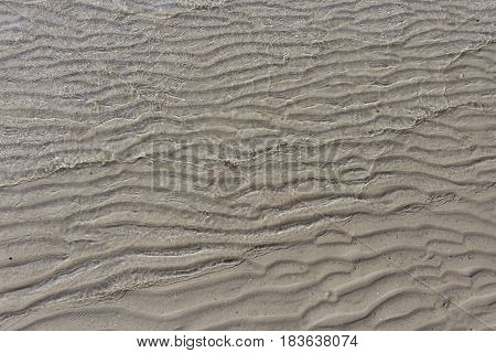Beautiful pattern in sand sculptured by wind