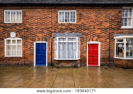 Blue and red doors with brick wall at England, UK. with brick wall at England, UK.