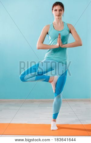 Beautiful girl engaged in yoga at gym