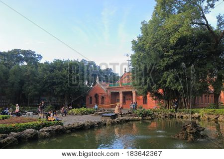 TAIPEI TAIWAN - DECEMBER 4, 2016: Unidentified people visit Oxford Aletheia University in Tamusi. Aletheia University was founded by George Leslie Mackay as Oxford College in 1882.