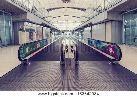 BANGKOK THAILAND - MARCH 7 2017 Moving escalator at the airport for passengers. walkway for passengers boarding walkway in airport. Passengers walk to the gate for boarding