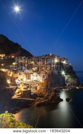 travel amazing Italy series - scenic night view of colorful village Manarola, Cinque Terre