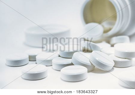 Isolated white drug pills tablets on white background.
