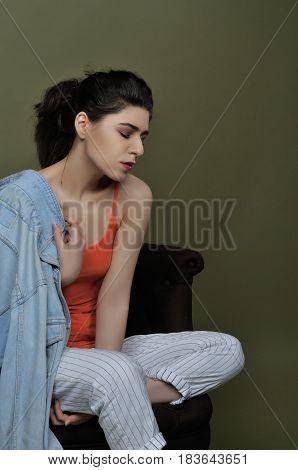 Portrait Of A Brunette In Profile In The Studio