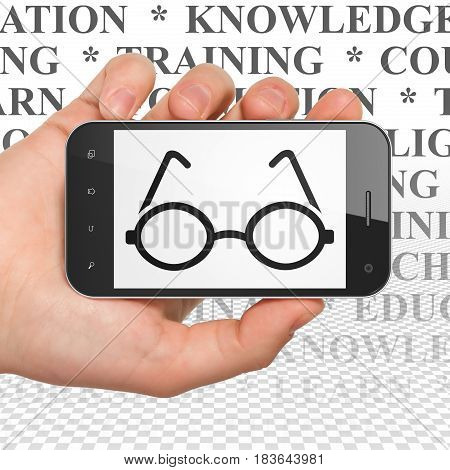 Studying concept: Hand Holding Smartphone with  black Glasses icon on display,  Tag Cloud background, 3D rendering