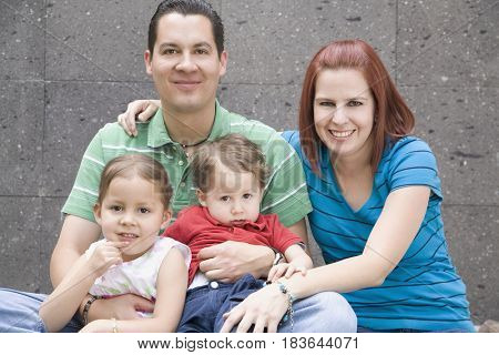 Hispanic family smiling