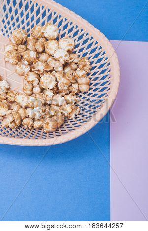 Sweet Popcorn In A Wicker Basket On A Light Background,