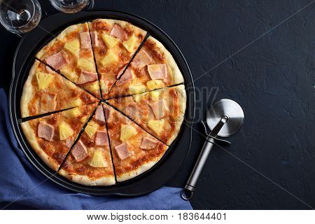Homemade Pizza Hawaii With Pineapple And Ham On Dark Stone Background.