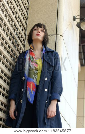 Beautiful Girl Standing Near The Closed Roller Shutters Store