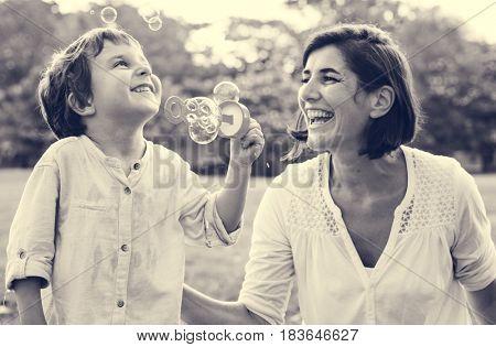 Teacher is teaching student do a bubbles