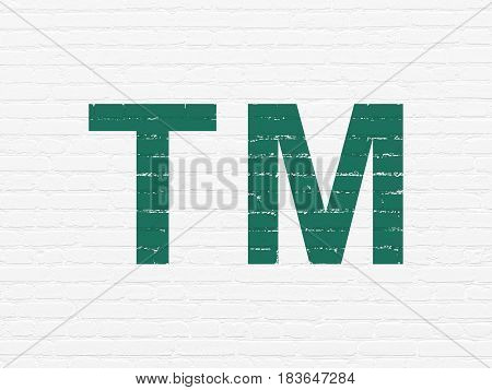 Law concept: Painted green Trademark icon on White Brick wall background