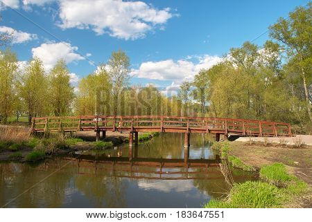 Wooden bridge on the Yauza river in Moscow in springtime
