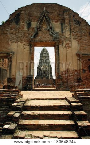 Tourists in Ancient ruins of Hindu temple in Ayutthaya in Thailand