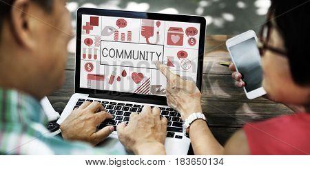 Seniors working on laptop network graphic overlay