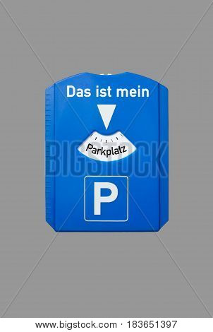 A parking disc with the german words for this is my parking lot, symbolizes parking problems