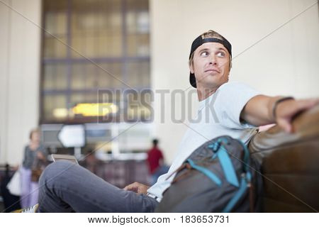 Caucasian man waiting in train station