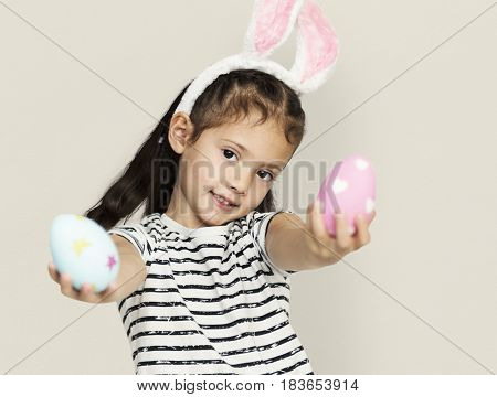 A girl with an easter eggs and bunny hairband