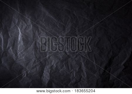 black cracked stone like texture background and light spot in the center