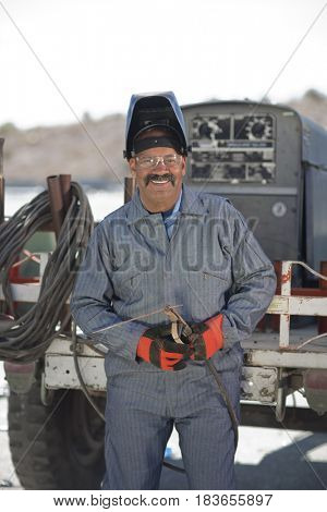 Hispanic sanitation working in recycling plant