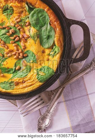 Frittata With Eggs, Spinach, Cheese And Pine Nuts