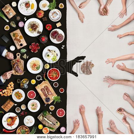 Wealth and poverty. View from above the table. A top view of a table with an abundance of food and a multitude of hands that stretch towards the bread