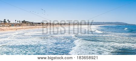 Many kilometers of coast of Southern California. Surf of the ocean on the beach. Waves are ideal for surfing. San Diego.
