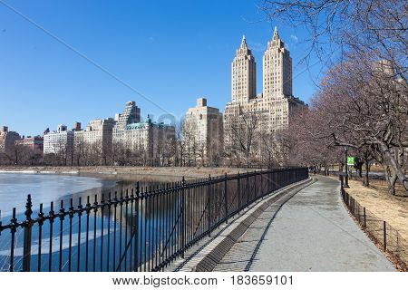 New York City - Panoramic view of modern buildings of upper west side Manhattan from Central Park with Jacqueline Kennedy Onassis Reservoir.