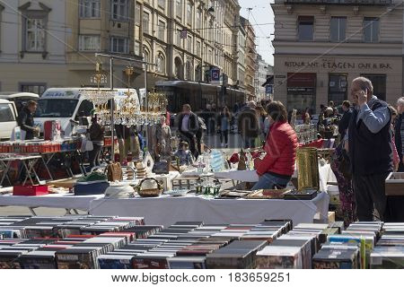 LINZ, AUSTRIA - MARCH 25, 2017:  Cds and vintage forniture in the Hauptplatz Fleamarket in Linz, Austria