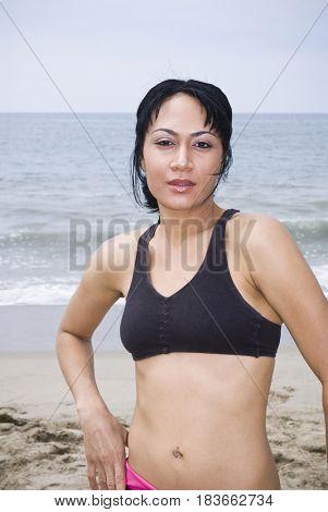 Mixed race woman standing on beach