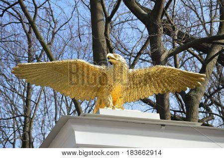 Symbolic golden eagle decorating the gate of ancient park