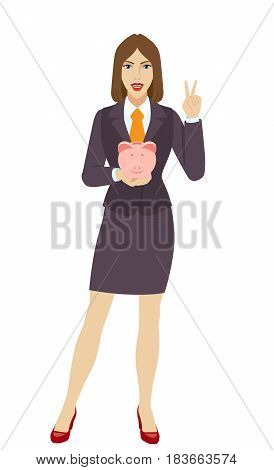 Businesswoman holding a piggy bank and showing victory sign. Two finger up. Full length portrait of businesswoman character in a flat style. Vector illustration.