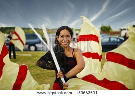 Pacific Islander girl flag twirling