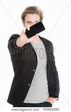 Mobile Phone In Hand Of Defocused Young Man In Jackets