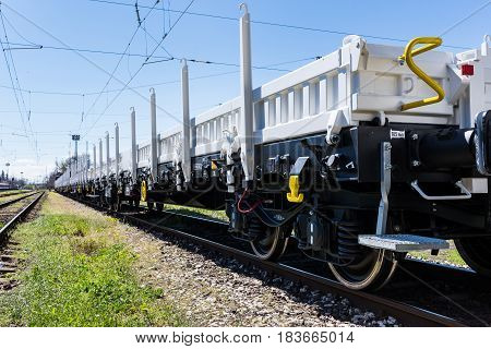 Burgas Bulgaria - March 20 2017 - Freight cargo train - 4axled flat wagon Type:Rens Model:192 B - Transvagon AD