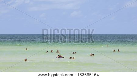 People Enjoy Swimming In South Beach In Miami