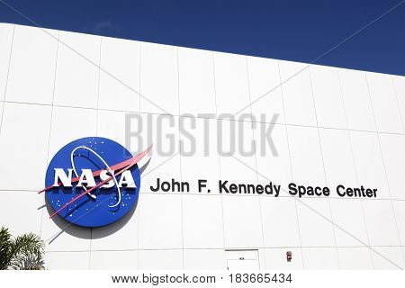 Facade Of Main Entrance For Tourists With John F. Kennedy Space Center And Nasa Emblem