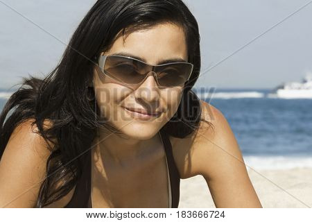 Hispanic woman enjoying the beach