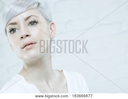 Closeup portrait of trendy young woman.