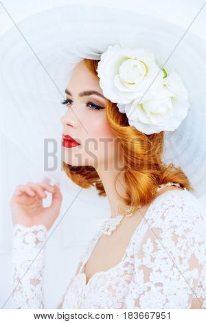 Portrait of a beautiful tender bride woman wearing elegant lace dress and broad-brimmed hat. Wedding. Beauty, fashion concept.
