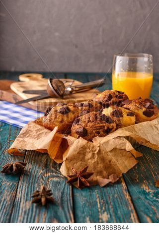 Damashnie muffins with chocolate chips and orange juice is not a wooden background