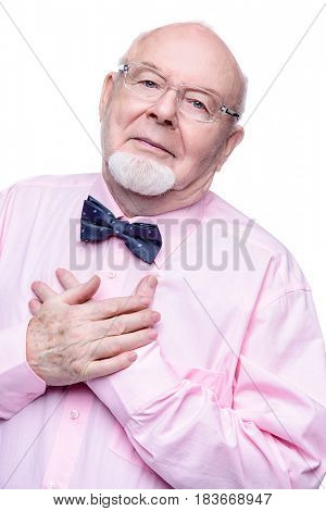 Handsome old man wearing elegant suit with bow-tie. Isolated over white.