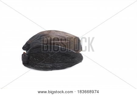 sliced black organic fermented onion on a white isolated background