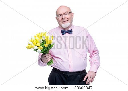 Happy smiling old man gives a bouquet of tulips flowers. Women's Day, 8 of March, birthday concept. Retirement. Isolated over white.