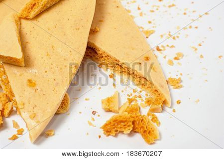 Pieces dessert caramel honeycomb on white background