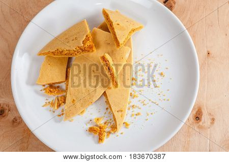 Caramel Honeycomb On A White Plate 04