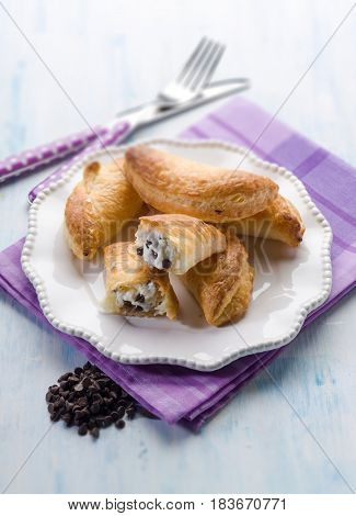french pastry filled with ricotta and chocolate drops, selective focus