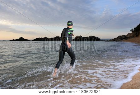 Young Athlete Triathlon In Front Of A Sunrise